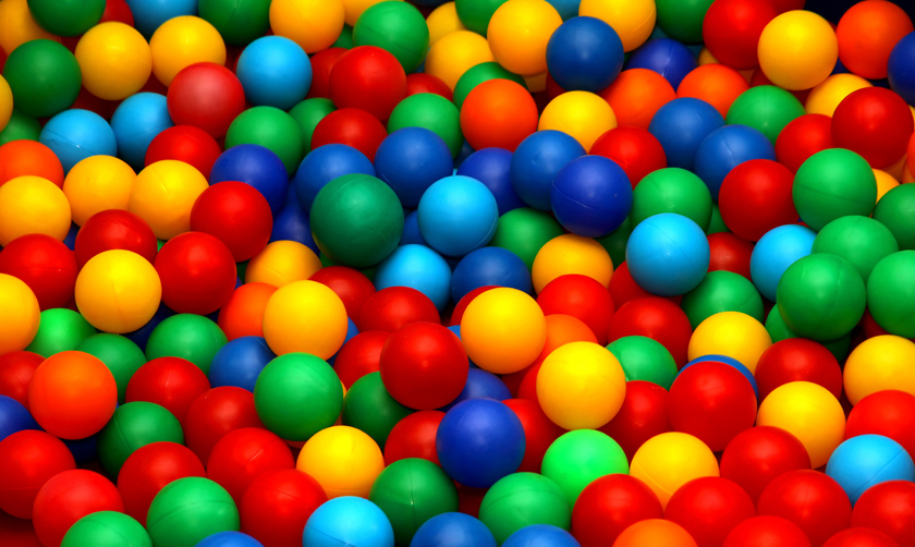 many colored balls for play fun in a swimming pool 2