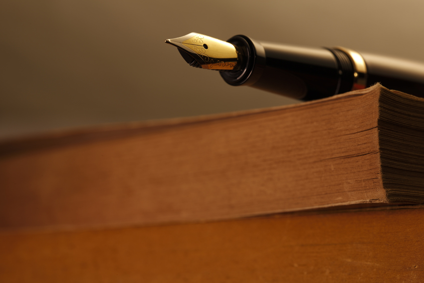 Old Books and Pen , shot with very shallow depth of field